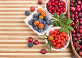 Fresh berries in a wooden background — Stock Photo