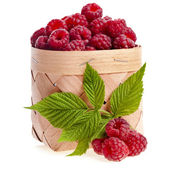 Raspberries in the wooden basket isolated on white — Stock Photo