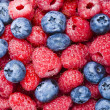 Raspberries and blueberries — Stock Photo