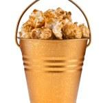 Full bucket box of caramel popcorn dropped — Stock Photo #17184257