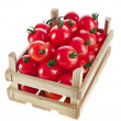 Fresh tomatoes in a wooden crate — Stock Photo