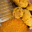 Turmeric curcuma root and powder with steel hand grater - Stock Photo