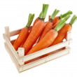 Fresh carrots in a wooden crate box — Stock Photo