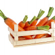 Fresh carrots in a wooden crate box — Stock Photo #17184635