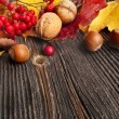 Autumn Leaves and nut over wooden texture background with copy space — Stock Photo #17184995