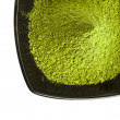 Stock Photo: Powdered green teover white