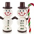 Sweet funny snowman made of marshmallow, chocolate, candy and jam - Stock Photo