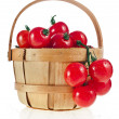 Cherry tomatoes in wooden basket — Stock Photo