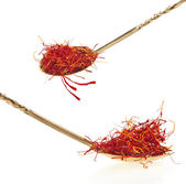 Stigmas of saffron in golden spoon — Stock Photo
