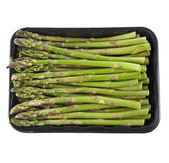 Asparagus in black plastic container on a white background — Stock Photo