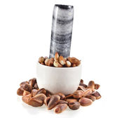 Cedar pine nuts in a marble mortar — Stock Photo
