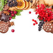 Christmas card of cookies, berries, fruits, different xmas ingredients and spices — Stock Photo