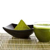 Powdered green tea on bamboo napkin texture — Stock Photo