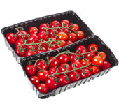 Cherry-tomaten in der kunststoff-container — Stockfoto