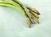 Asparagus in tablecloth — Stock Photo