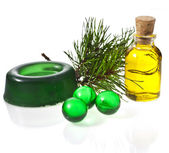 Pine oil in bottles, soap and bath ball — Stock Photo