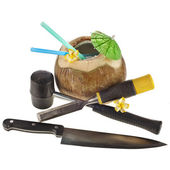 Fruit of coconut tree with tools for opening — Stock Photo