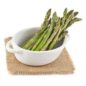 Asparagus in ceramic pot isolated on a white background — Stock Photo