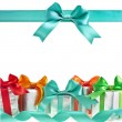 Colorful gift boxes with bows isolated on white background — ストック写真