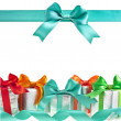 Colorful gift boxes with bows isolated on white background - Foto Stock