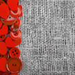 Border of red buttons and hearts on canvas burlap background texture - 图库照片