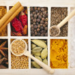 Assortment collection of powder spices on spoons in wooden box background — Stock Photo #21188925