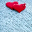 Valentine's day card, red heart symbol with needle on fabric sack texture background - Foto Stock