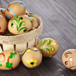Easter egg in basket on black wooden background with copy space for your text — Stock Photo