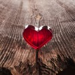 Photo: Love heart on Wood texture background, valentines day card concept