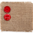 Buttons on canvas burlap background texture isolated on a white background - Stock Photo
