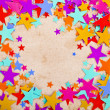 Colorful stars on old retro paper background — Photo