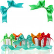 Colorful gift boxes with bows isolated on white background — Stok fotoğraf