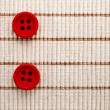 Red buttons cotton fabric texture — Stock Photo