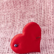 Valentine's day card with red heart symbol with pin on fabric sack texture background - 图库照片