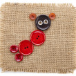 Royalty-Free Stock Photo: Cute Animal made of buttons on burlap canvas texture isolated on a white background