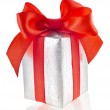 Present box with red ribbon bow isolated on white — Stock Photo #21189221