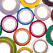 Stock Photo: Colored circles roll of adhesive tape isolated on white background