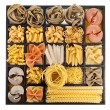 Italian pasta collection in wooden box background — Stock Photo #21189299