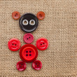 Cute Animal made of buttons on burlap canvas background texture — Stock Photo