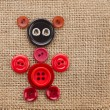 Cute Animal made of buttons on burlap canvas background texture — Stock Photo #21189461