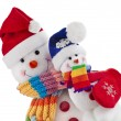 Christmas snowman with wool scarf and santa claus hat , isolated on white background — Stock Photo #21189577