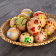 Painted colorful easter eggs on black wooden background with copy space for your text — Stock Photo #21189617