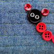 Cute Animal Made of buttons on a jeans texture background — Stock Photo