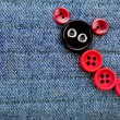 Royalty-Free Stock Photo: Cute Animal Made of buttons on a jeans texture background