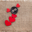 Valentine's day card with wooden red hearts symbol on fabric sack texture background - 图库照片