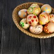 Painted colorful easter eggs on black wooden background with copy space for your text — Stock Photo #21189901