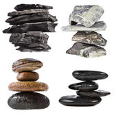Stack tower of black coal , marble, cobble rock, isolated on white background — Stock Photo