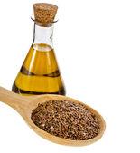 Olej ze semen lnu láhev izolovaných na bílém pozadí — Stock fotografie