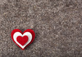 Heart symbol on wool felt texture with copy space — Stock Photo