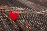 Love heart on crack wooden texture background, valentines day card concept — Stock Photo